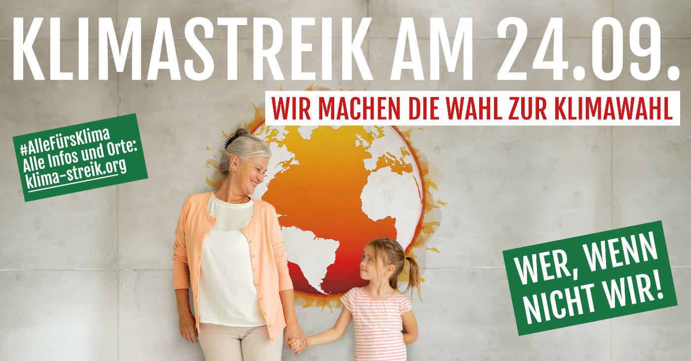 Ein Demoaufrauf zum großen KLimastreik am 24. September. Eine Großmutter und ihre Enkelin halten sich darauf an den Händen.
